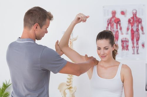Physical therapist and patient concept of accident injury treatments