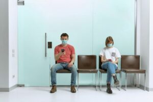 Patients in waiting room concept of preparing for injury doctor appointment