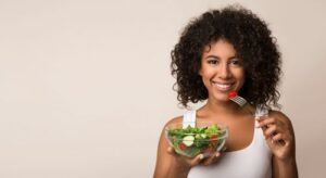 Woman eating salad concept of healthy lifestyle following an auto accident