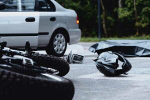 Motorcycle hit by car motorcycle accident injuries concept